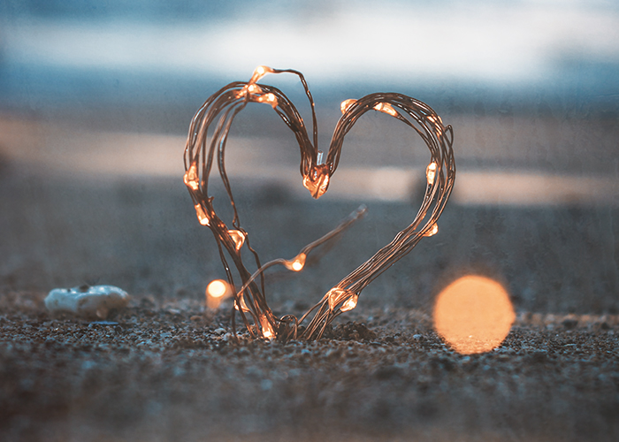 Heart shaped LED cable on the beach